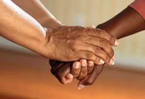grief support holding hands