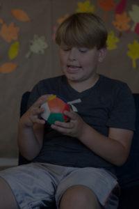 kid with ball image