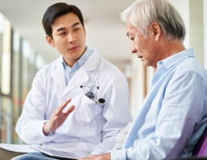 Doctor having serious conversation with patient