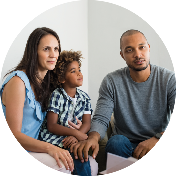 Family of three w/ young child in counseling session